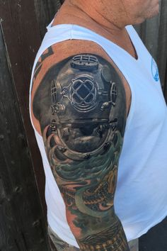 Antique dive helmet tattoo by Monte Livingston at Living Art Gallery Tattoo Lounge in San Clemente, Ca. #divehelmet #divehelmettattoo #photorealism #montelivingston #livingartgallery #sanclementetattoos #antiquetattoo