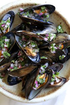 Steamed mussels get a kick with spicy Piri Piri Sauce which is basically a kicked up chimichurri sauce.