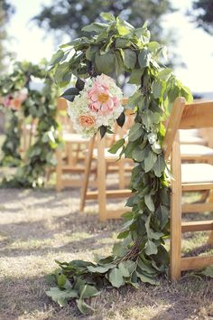 Aisle chairs decorated with beautiful Eucalyptus garlands accented with garden Roses. #wedding #garland