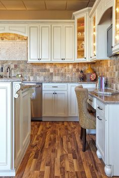 I like the detail on these cabinets and the idea of having a desk. Not sure about the floor/backsplash combo...