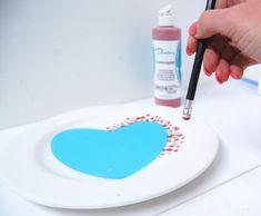 Pencil rubber dot plate using our reusable heart silhouette, a ceramic bisque pottery plate and Duncan Ceramics Concepts Underglaze.