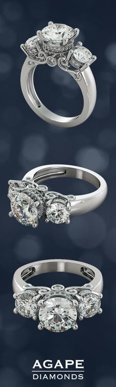 This extraordinary round cut three-stone engagement ring is truly a work of art. A stunning round center stone set high on a signature regal crown is flanked by 2 equally stunning round stones and decorated with beaded pave stones. A luminous peek-a-boo stone set amidst the gallery is surrounded by artistic see-through filigree scrolls completing a dazzling look she will absolutely love.