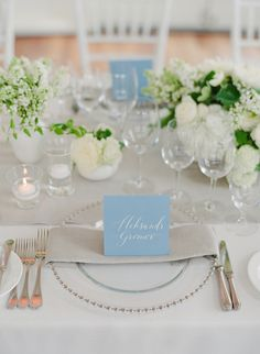 Mixed arrangements with smaller, single-flower-type arrangements, on a long table