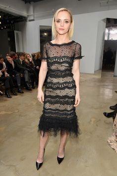 Carolina Herrera dressed Christina Ricci in a Resort 17' black lace dress with embroideries to the Fall Winter '17 show in New York on Monday, February 13th.