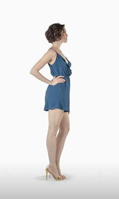 The Lola Romper in Petroleum Blue Crepe | Who doesn't love a jumpsuit short? It's definitely the best choice for a hot summer day on the beach or in town.  JOSA tulum Lola is the next best thing to going naked, with its spaghetti straps, loose fit and V-cut neckline that shows all your sexy assets . . . or you can clip button for a less showy occasion.
