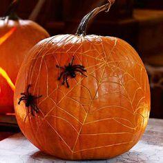spider web carved pumpkin