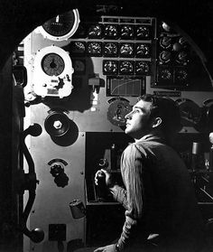 May 1945 - Sailor at work in the electric engine control room of USS Batfish (SS-310) on war patrol.