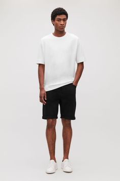 A relaxed fit, these casual shorts are made from worn denim with a soft washed quality. A classic five-pocket style, they have a zip fly fastening, belt loops and casual turn-up cuffs. Inside leg length of size is / Model is tall and wearing a size 32 Black Denim Shorts, Casual Shorts, Cos Man, Mens Modern Clothing, Small Wardrobe, White Shirts, Trousers, Menswear, Mens Tops
