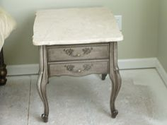 This end table lived in my parents home for over 30 years (maybe even 40). There are 2 of them and they have cream colored marble tops (you...