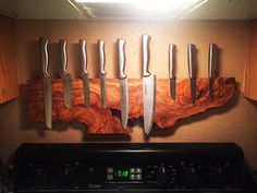 Custom magnetic knife rack made from burled olive wood.
