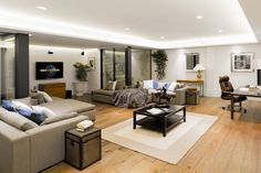 Granit Architects Luxury Home in Barnes, South West London Living room, games room, cosy space