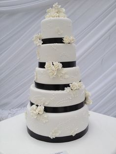 Five Tier White Fondant Wedding Cake with Hand Piping, Rosebud and Black Ribbon Decor