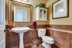 Traditional Powder Room with Barclay Hampshire 31.5-in H White Vitreous China Complete Pedestal Sink, limestone tile floors