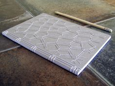 Voronoi with his Shadow Embroidered Notebook. by FabulousCatPapers