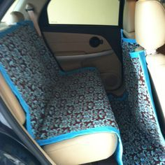 Washable car seat and floor cover. Hopefully this helps prevent dog fur from getting in the carpet. Would probably work for kids too!