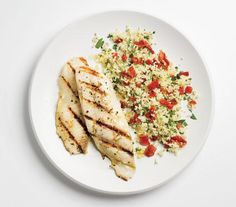 Garlicky Grilled Tilapia With Couscous | Trying to cut back? These tasty dinners all clock in at less than 400 calories per serving.