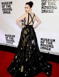 LIly Collins attends the Museum Of The Moving Image 30th Annual Salute Honoring Warren Beatty wearing an Elie Saab Haute Couture gown on November 02, 2016.