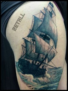 Full-rigged ship tattoo on the right thigh.