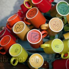 For a coffee lover like me, I love the idea of colored coffee mugs as favors.