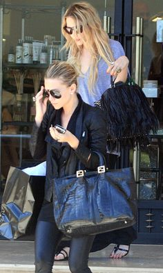 Mary-Kate and Ashley Olsen go shopping in casual cool looks. #style #fashion #olsentwins