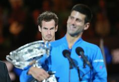 Andy Murray of Great Britain looks on as Novak Djokovic of Serbia holds the Norman Brookes Challenge Cup after he won their men's final match during day 14 of the 2015 Australian Open at Melbourne Park on February 1, 2015 in Melbourne, Australia.  http://www.mirror.co.uk/sport/tennis/australian-open-2015-andy-murray-5087493