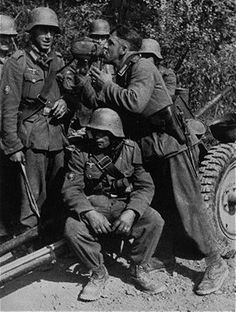 German army | These men are part of mountain troops unit. You can tell by the Jager badge on the upper right arm two men on left, as well as the boots.