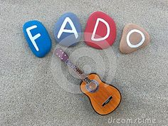 Stones conposition and a miniature of guitar symbols of Fado, portuguese traditional music