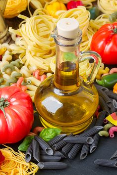 Jar of Olive oil with raw pasta and tomatoes by Anastasy Yarmolovich #AnastasyYarmolovichFineArtPhotography  #ArtForHome #Food