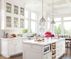 White subway tile in the backsplash plays well with an all-white pallete in this kitchen