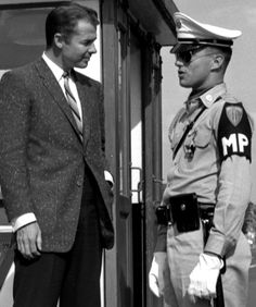 Audie Murphy, America's most decorated soldier of World War II, talks with an MP during a visit to Würzburg to film a documentary about missiles being used by the Army.