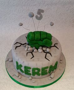 Hulk inspired cake with Hulks fist smashing through