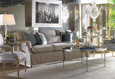 mirror treatment on wall...couch, cool colors, crystal, mirrored, beautiful chairs