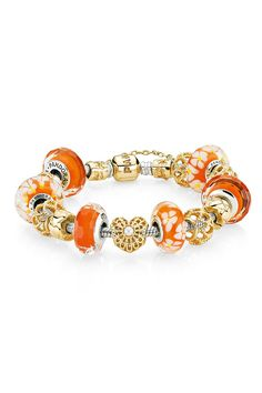 pandora > This looks like one of mine, but this is not mine.  I have the orange glass, gold beads and a gold bracelet.  Someone's got the same taste.