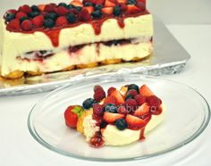 A gorgeous no-bake white chocolate cheesecake with lots of berries
