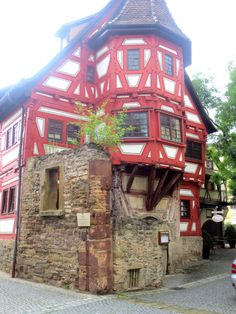 The oldest house in Stuttgart, Germany. It looks like a corner of medieval structure still stands.