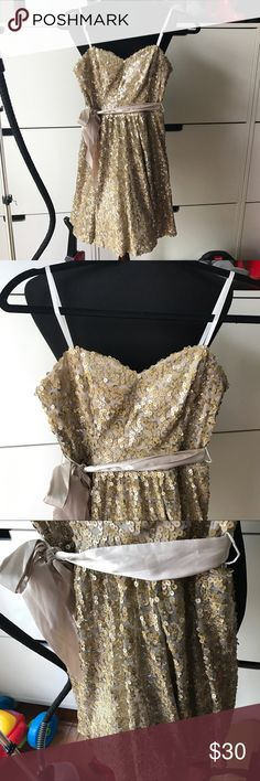 Gold sequin dress Two toned sequins. Gold and silver tone to give nice shimmery color. Worn once for a graduation and that's it! Sash has small pull from the sequins. Size 3 juniors! Way-In Dresses Strapless
