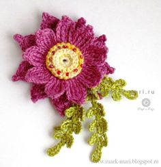 Pink-purple flower - flower about 6 cm diameter (without leaves). Made of cotton yarn of three colors, red beads and hook 1, 3 mm
