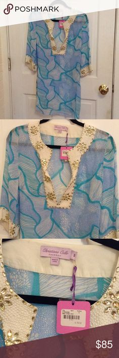 Summer beach cover up Never been worn summer beach cover up, blue and aqua tones with decorated sleeve and front Calypso St. Barth Swim Coverups