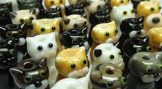 Lampwork glass cat beads by Laura Sparling