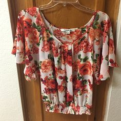 Forever 21 Floral Sheer top Forever 21 floral sheer top with wide short sleeves and fitted (but stretchy) bottom. Size small Forever 21 Tops Blouses