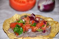 Tostada with cheese, beans and tomatoes