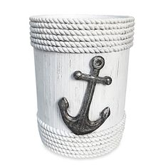 Add a touch of the salty seas to your kitchen decor with this nautical-themed utensil crock. This convenient utensil holder is shaped like a dock piling and features a large central anchor. A coiled rope design bands the top and bottom to finish the look.