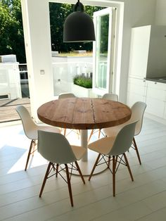 Reclaimed vintage wood round dining table, white base.