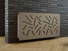 Add interest to a radiator cover with unusual cut-out shapes.