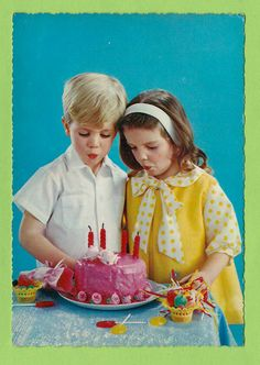 Vintage post card, boy and girl blowing out candles on birthday cake, 1950's.
