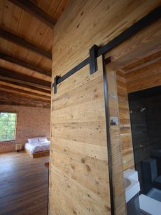 Architecture: Spacious Bedroom Designed With Exposed Beams On Striped Wooden Ceiling Completed With Industrial Style Bathroom Inside