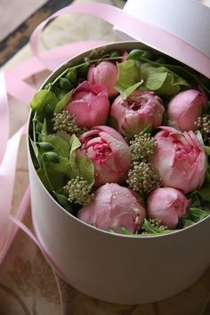 a hat box full of peony blooms