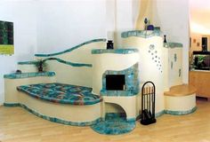 Rocket Mass Heater: stove, bench with cob house! ~ while very beautiful this isn't one I'd want in my house Cob Building, Green Building, Building A House, Earthship, Rocket Mass Heater, Stove Heater, Permaculture Design, Tadelakt, Natural Homes