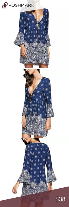 """💙Sexy Tied Front Bell Sleeves Mini Dress/Tunic💙 Brand New. Ladies this is gorgeous/sexy. Can be worn as a mini dress(depending how tall you are) or as a tunic. Blue/white print. Tide front. If you did not want to tie the front recommended an under tank. Bell sleeves. Very comfortable. When tied in front there is a keyhole. Size small. This top bust area fits on the smaller side. Manufactures material information: Cotton+polyester. Bust: approx 18"""" (laying flat) Length:approx 35"""" . Deep V…"""