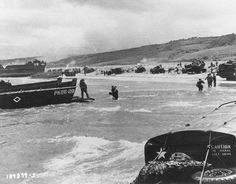 Scene on Omaha Beach, june 6,   1944. Note LCI(L)-553 in background and a LCVP from APA Samuel Chase in left center.